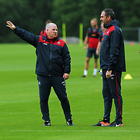 Pictured L-R: Assistant coach Nigel Gibbs speaks with manager Paul Clement. Tuesday 11 July 2017<br /> Re: Swansea City FC training at Fairwood training ground, UK