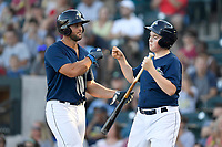 Designated hitter Tim Tebow (15) of the Columbia Fireflies is congratulated by the bat boy after scoring a run in a game against the Lexington Legends on Thursday, June 8, 2017, at Spirit Communications Park in Columbia, South Carolina. Columbia won, 8-0. (Tom Priddy/Four Seam Images)