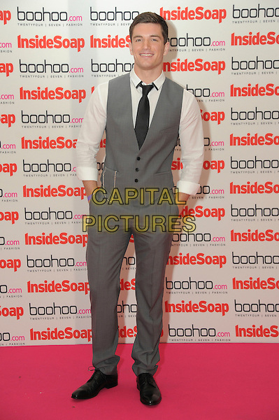 David Witts.The Inside Soap Awards 2012, One Marylebone,  London, England..September 24th, 2012 .full length white shirt grey gray trousers waistcoat hands in pockets .CAP/CAS.©Bob Cass/Capital Pictures.