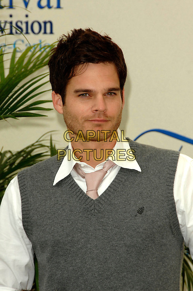 "GREG RIKAART .Photocall promoting the television series ""Les Feux de l'Amour (The Young and the Restless)"" on the third day of the 2008 Monte Carlo Television Festival held at Grimaldi Forum, Monaco, Principality of Monaco..June 10th, 2008.half length grey gray sleeveless jumper stubble facial hair .CAP/TTL .© TTL/Capital Pictures"