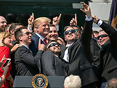 United States President Donald J. Trump poses for a selfie as he hosts Martin Truex Jr., the NASCAR Cup Series champion, and his team, on the South Lawn of the White House in Washington, DC on Monday, May 21, 2018.  Truex competes full-time in the Monster Energy NASCAR Cup Series for Furniture Row Racing.<br /> Credit: Ron Sachs / CNP