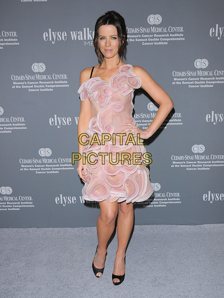 KATE BECKINSALE .Attends The 4th Annual Pink Party held at Santa Monica Airport Hanger 8 in Santa Monica, California, USA, .September 13th 2008.                                                                     .full length pink white ruffle dress textured hand on hip black peep toe shoes Christian Louboutin .CAP/DVS.©Debbie VanStory/Capital Pictures