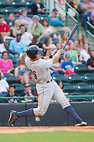 Aaron Judge (35) of the Charleston RiverDogs follows through on his swing against the Hickory Crawdads at L.P. Frans Stadium on May 25, 2014 in Hickory, North Carolina.  The RiverDogs defeated the Crawdads 17-10.  (Brian Westerholt/Four Seam Images)