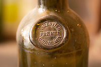 An old antique dusty wine bottle with a moulded seal on the shoulder of the bottle, probably early 19 century, seal showing the text Forestier Freres Bordeaux  Chateau Belingard Bergerac Dordogne France
