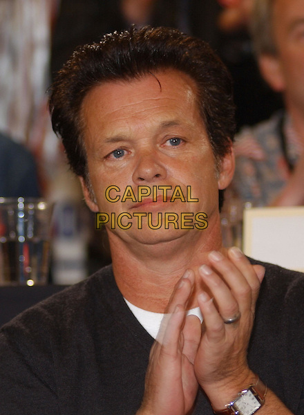 JOHN MELLENCAMP.during Farm Aid 2004 held at White River Amphitheatre, Seattle, WA, USA, September 18th 2004..half length clapping.Ref: ADM.www.capitalpictures.com.sales@capitalpictures.com.©GS/AdMedia/Capital Pictures .