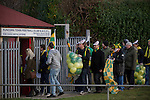 Away supporters arriving at the turnstiles before the Boxing Day derby match between Runcorn Town and visitors Runcorn Linnets at the Pavilions, Runcorn, in a top-of the table North West Counties League premier division match. Runcorn Linnets won 1-0 and overtook their neighbours at the top of the league in a game watched by 803 spectators. Runcorn Linnets were a successor club to Runcorn FC, one of England foremost non-League clubs of the 1970s and 1980s.