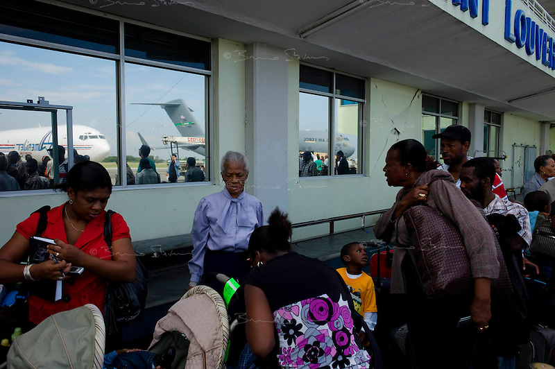 Port Au Prince, Haiti, Jan 19, 2010.Foreign Nationals are being evacuated from 'Toussaint Louverture International Airport' by their respctive governments; a group of US citizens prepare to board a flight to Miami..