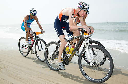13 JUL 2013 - DEN HAAG, NED - Cornelis Scheltinga (NED) (second from the left, #40, in dark blue and orange) of the Netherlands races along the beach with Jarrich Van Woersem (NED) (right #51, in dark blue and orange) also of the Netherlands and Tim Van Daele (BEL) (left) of Belgium during the 2013 ITU Cross Triathlon World Championships in Kijkduin in Den Haag (The Hague), the Netherlands (PHOTO COPYRIGHT © 2013 NIGEL FARROW, ALL RIGHTS RESERVED)