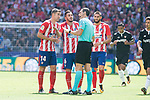 Atletico de Madrid's Gabi Fernandez, Koke Resurreccion and Yannick Carrasco talking with the referee during La Liga match between Atletico de Madrid and Sevilla FC at Wanda Metropolitano Stadium in Madrid, Spain September 23, 2017. (ALTERPHOTOS/Borja B.Hojas)