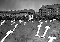 These markers are for the graves of 80 victims of the Nazis found in Ludwigslust.  The entire population of Schwerin, Germany, was ordered by the Military Government to attend fureral rites conducted by U.S. Army chaplains.  May 8, 1945.  A. Drummond, Jr. (Army)<br /> NARA FILE #:  111-SC-206611<br /> WAR &amp; CONFLICT BOOK #:  1128