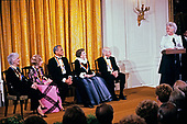 First lady Barbara Bush makes remarks during a ceremony for 1989 Kennedy Center Honorees in the East Room of the White House, December 3, 1989 in Washington, DC. The 1989 honorees are, from left to right: actress and singer Mary Martin, dancer Alexandra Danilova, singer and actor Harry Belafonte, actress Claudette Colbert, and composer William Schuman.<br /> Credit: Peter Heimsath / Pool via CNP