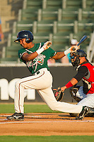 Jose Duarte #15 of the Greensboro Grasshoppers follows through on his swing against the Kannapolis Intimidators at Fieldcrest Cannon Stadium August 3, 2010, in Kannapolis, North Carolina.  Photo by Brian Westerholt / Four Seam Images