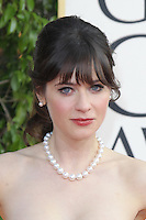 BEVERLY HILLS, CA - JANUARY 13: Zooey Deschanel at the 70th Annual Golden Globe Awards at the Beverly Hills Hilton Hotel in Beverly Hills, California. January 13, 2013. Credit: mpi29/MediaPunch Inc. /NortePhoto