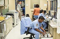 Nurses work at the hospital at Central Prison in Raleigh, NC on Thursday, November 17, 2016. (Justin Cook)