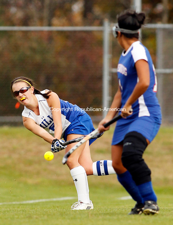 Burlington, CT- 18, October 2010-101810CM02  Lewis Mills Megan Osanitsch clears the ball upfield as Nonnewaug's Lauren Villanova (right) defends during Berkshire Field Hockey action Monday afternoon in Burlington.  Nonnewaug blanked Mills 3-0, remaining undefeated on the season.  Christopher Massa Republican-American