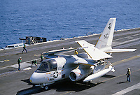 United States Navy aircraft folds wings before storage in hangar after landing on USS Nimitz