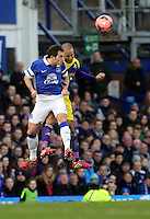 Pictured: Ashley Jazz Richards of Swansea (R) heads the ball. Sunday 16 February 2014<br />