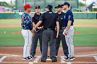 Jacksonville Jumbo Shrimp manager Randy Ready (5) in a meeting with the umpires before a game against the Mobile BayBears on April 14, 2018 at Baseball Grounds of Jacksonville in Jacksonville, Florida.  Mobile defeated Jacksonville 13-3.  (Mike Janes/Four Seam Images)
