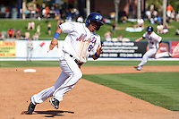 New York Mets Wilfredo Tovar #85 rounds the bases during an exhibition game vs the Michigan Wolverines at Digital Domain Ballpark in Port St. Lucie, Florida;  February 27, 2011.  New York defeated Michigan 7-1.  Photo By Mike Janes/Four Seam Images