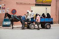 Rissani, Morocco.  Horse-drawn Cart Preparing to Take Women Shoppers Home.