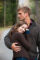 Young man with arm around young woman