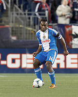 Philadelphia Union midfielder Amobi Okugo (14) passes the ball. In a Major League Soccer (MLS) match, the New England Revolution (blue/red) defeated Philadelphia Union (blue/white), 2-0, at Gillette Stadium on April 27, 2013.