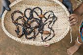 Xingu Indigenous Park, Mato Grosso State, Brazil. Aldeia Ilha Grande (Kaiabi). Traditional peneira sieve basket and necklaces.