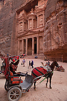 The immense Treasury carved into the Nubian Sandstone dominates the dramatic entrance into the lost city of Petra.