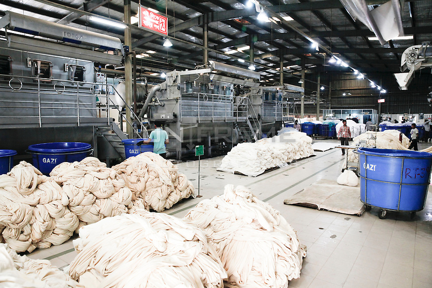 Bangladeshi garments worker works in the dyeing section of a garments. Gazipur, near Dhaka, Bnagladesh