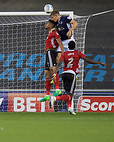 Shaun Hutchinson of Millwall wins the header from Dominic Iorfa of Ipswich Town during the Sky Bet Championship match between Millwall and Ipswich Town at The Den, London, England on 15 August 2017. Photo by Alan  Stanford / PRiME Media Images.