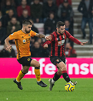 Wolverhampton Wanderers' Ruben Neves (left) battles for possession with Bournemouth's Lewis Cook (right) <br /> <br /> Photographer David Horton/CameraSport<br /> <br /> The Premier League - Bournemouth v Wolverhampton Wanderers - Saturday 23rd November 2019 - Vitality Stadium - Bournemouth<br /> <br /> World Copyright © 2019 CameraSport. All rights reserved. 43 Linden Ave. Countesthorpe. Leicester. England. LE8 5PG - Tel: +44 (0) 116 277 4147 - admin@camerasport.com - www.camerasport.com