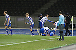 Home striker Gojko Kacar (on ground) is congratulated by teammates after scoring the only goal as Hertha Berlin take on Sporting Lisbon at the Olympic Stadium in Berlin in the group stages of the UEFA Europa League. Hertha won the match by 1 goal to nil to press to the knock-out round of the cup. 2009/10 was the the first year in which the Europa League replaced the UEFA Cup in European football competition.