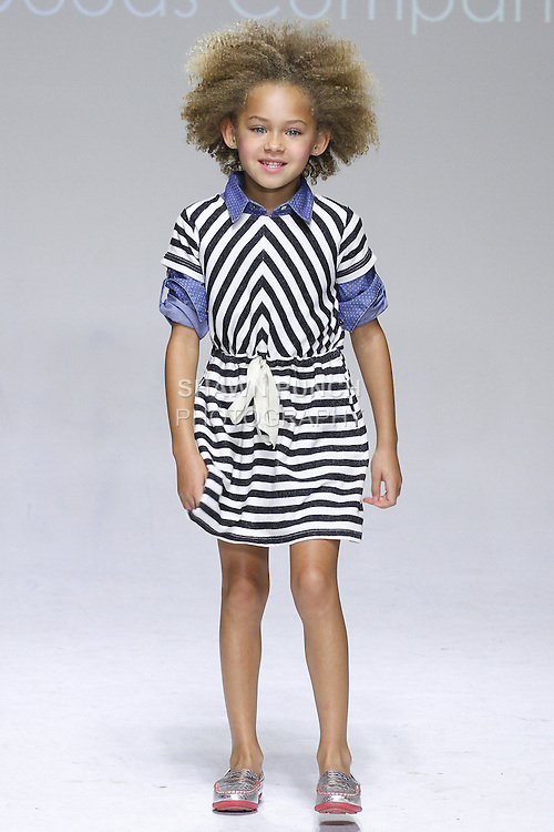 Young model walks runway in shoes from the Anasai Spring Summer 2015 collection, at petitePARADE Spring Summer 2015, during Kids Fashion Week in New York City, on October 18, 2014.