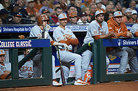 Texas Longhorns assistant coach Troy Tulowitzki (second from left) and Texas Longhorns student assistant Huston Street (second from right) watch the action from the dugout during the game against the LSU Tigers in game three of the 2020 Shriners Hospitals for Children College Classic at Minute Maid Park on February 28, 2020 in Houston, Texas. The Tigers defeated the Longhorns 4-3. (Brian Westerholt/Four Seam Images)