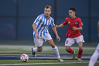 Malden, Massachusetts - June 23, 2018:  The Boston City FC (red/white) played the Seacoast United Mariners (blue/white) to a 1-1 draw in a National Premier Soccer League (NPSL) match at the Brother Gilbert Soccer field.
