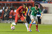 Bridgeview, IL, USA - Tuesday, October 11, 2016: Panama defender Michael Amir Murillo (13) and Mexico forward Oribe Peralta (19) during an international friendly soccer match between Mexico and Panama at Toyota Park. Mexico won 1-0.