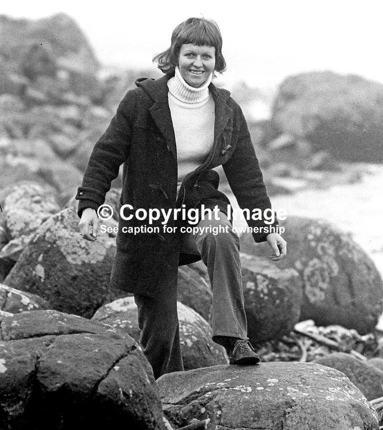 A duffle-coated Rev Ruth Patterson, Larne, Co Antrim, N Ireland, the first woman to be ordained into the ministry of the Presbyterian Church in Ireland. January 1976, has a stroll along the Co Antrim shore. 197601030002b<br /> <br /> Copyright Image from Victor Patterson, 54 Dorchester Park, Belfast, UK, BT9 6RJ<br /> <br /> Tel: +44 28 9066 1296<br /> Mob: +44 7802 353836<br /> Voicemail +44 20 8816 7153<br /> Skype: victorpattersonbelfast<br /> Email: victorpatterson@me.com<br /> Email: victor@victorpatterson.com<br /> <br /> IMPORTANT: If you wish to use this image or any other of my images please go to www.victorpatterson.com and click on the Terms &amp; Conditions. Then contact me by email or phone with the reference number(s) of the image(s) concerned.