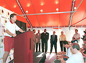 Washington Redskins head coach Norv Turner announces that linebacker LaVar Arrington (56), the Redskins first pick in the first round of the 2000 NFL Draft (second pick overall), out of Penn State University, has agreed to a 6 year contract with a $10.75 million signing bonus at Redskins Park in Ashburn, Virginia on July 22, 2000. Looking on in the background, from left to right:  Kevin Poston and Carl Poston, Arrington's agents; Arrington; Redskins owner Dan Snyder and team investor Fred Drasner.  Washington Post photographer Rich Lipski stands at far right.<br /> Credit: Arnie Sachs / CNP