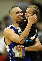 Saints guard Lindsay Tait celebrates victory with his four-year-old son Mikaere during the National Basketball League match between the Wellington Saints and Harbour Heat at TSB Bank Arena, Wellington, New Zealand on Thursday, 29 April 2010. Photo: Dave Lintott / lintottphoto.co.nz
