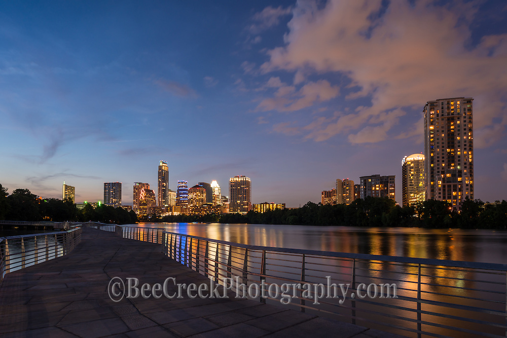 Austin Skyline at Night from the new<br /> boardwalk. You get the nice reflection of the city lights in the water of town lake to creates a vibrant night scene. I set this shot up to capture some of the board walk in the photo as I like the way it draws you eye down the boardwalk to the city skyline.