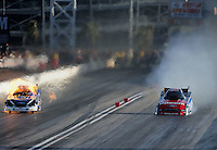 Mar. 31, 2012; Las Vegas, NV, USA: NHRA funny car driver Robert Hight (left) blows an engine alongside Bob Tasca III during qualifying for the Summitracing.com Nationals at The Strip in Las Vegas. Mandatory Credit: Mark J. Rebilas-US PRESSWIRE