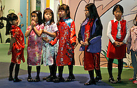 A group of young singers waits to perform a traditional Chinese song during a ceremony to announce the name of Zoo Atlanta?s giant panda cub. ?Mei Lan,? which translates to ?Atlanta Beauty? won in an online poll, receiving 22% of the 57,015 votes cast. Voters were given a list of 10 names from which to choose. The names were suggested by several institutions interested in panda conservation including local media, Zoo Atlanta staff and volunteers, Panda Express (a Zoo Atlanta sponsor) and the people of China.<br />