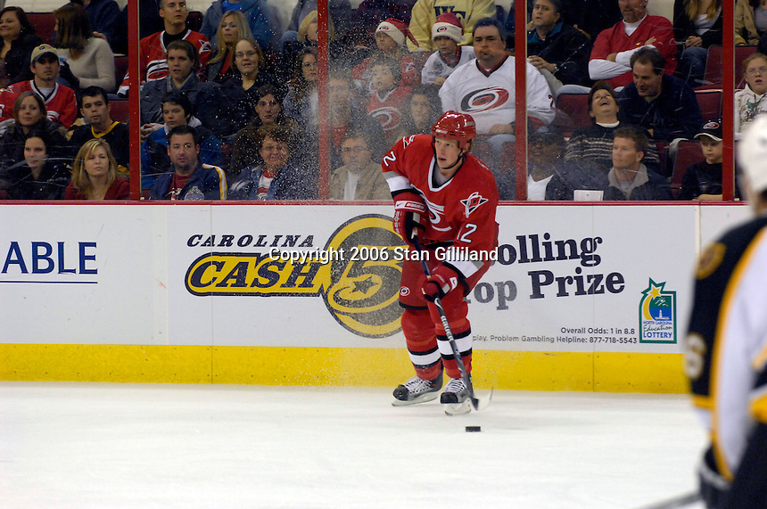 The Carolina Hurricanes' Eric Staal (12) checks out the defense of the Boston Bruins during an NHL hockey game Saturday, Dec. 2, 2006 in Raleigh, N.C. Carolina won 5-2.<br />