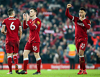 Liverpool's Alex Oxlade-Chamberlain, Andrew Robertson and Dejan Lovren celebrate on the pitch after the match<br /> <br /> Photographer Alex Dodd/CameraSport<br /> <br /> The Premier League - Liverpool v Manchester City - Sunday 14th January 2018 - Anfield - Liverpool<br /> <br /> World Copyright &copy; 2018 CameraSport. All rights reserved. 43 Linden Ave. Countesthorpe. Leicester. England. LE8 5PG - Tel: +44 (0) 116 277 4147 - admin@camerasport.com - www.camerasport.com
