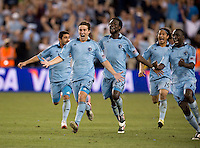 Matt Besler, Kei Kamara, Lawrence Olum. Sporting Kansas City won the Lamar Hunt U.S. Open Cup on penalty kicks after tying the Seattle Sounders in overtime at Livestrong Sporting Park in Kansas City, Kansas.