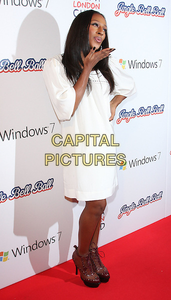 ALEXANDRA BURKE.At the 95.8 Capital FM Jingle Bell Ball in association with Windows 7,. O2 Arena, London , England, UK,.December 4th 2010..full length white dress hand on hip brown platform ankle boots lace-up blowing kiss .CAP/ROS.©Steve Ross/Capital Pictures