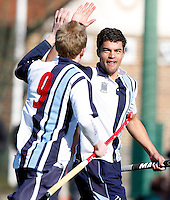 Jordache Rawson (R) high fives Andrew Cornick after he opened the scoring for Hampstead during the EHL Mens Cup Quarter-Final game between Hampstead and Westminster and Old Loughtonians at the Paddington Recreation Ground, Maida Vale on Sun Mar 7, 2010