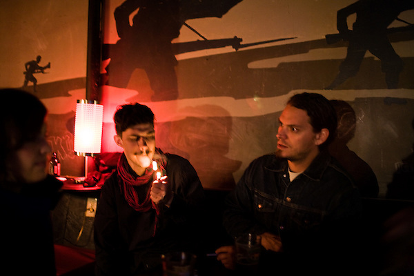 March 25, 2009. Carrboro, NC.. The Danish band, Efterklang, got drinks at the Reservoir Bar before playing a packed show at the Local 506 in Chapel Hill. They were on their way from  good showing at South By Southwest in Austin, TX.. Rasmus lights a cigarette.