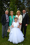 16/05/2015 - Mell Communion – Emily Grifferty wither parents Catriona and Tony and grandparents Mary and David Hannan. Picture: www.newsfile.ie