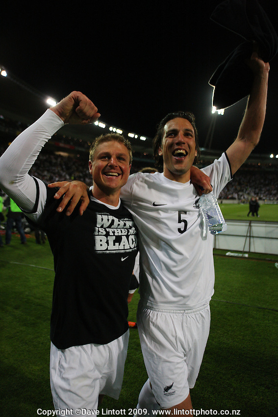 All Whites Ben Sigmund and Ivan Vicelich celebrate during the second leg of the FIFA World Cup soccer qualifying play-off between New Zealand All Whites and Bahrain at Westpac Stadium, Wellington, New Zealand on Saturday, 14 November 2009. Photo: Dave Lintott / lintottphoto.co.nz